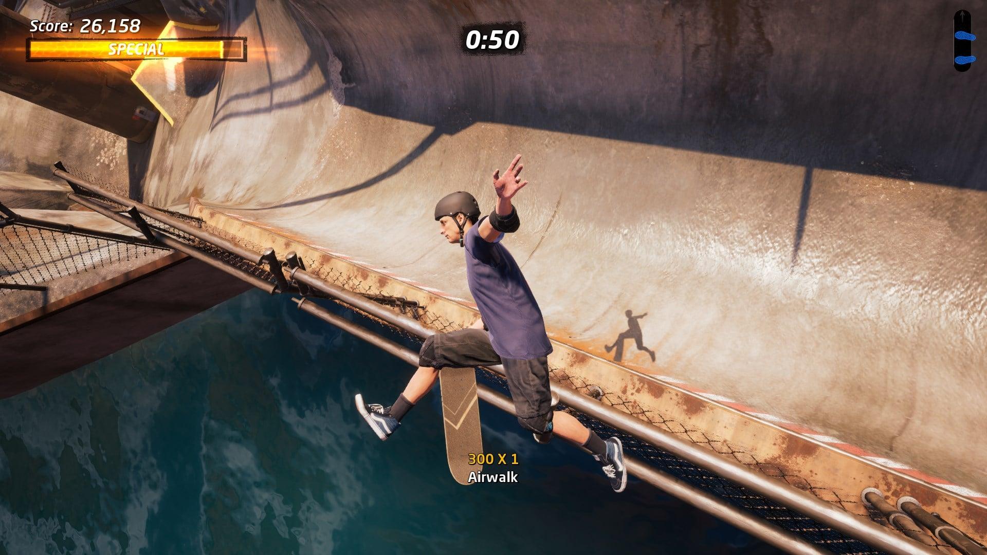 Tony Hawk air walking over a half pipe