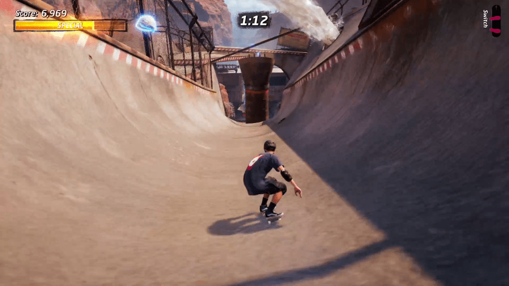 Hard hat 2 in Downhill Jam is on the left side of the downhill half pipe