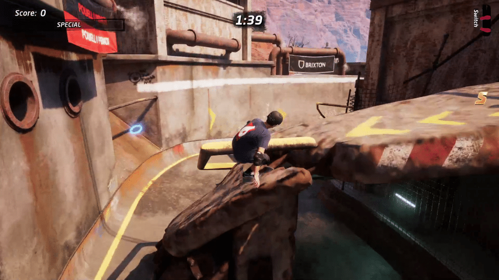 There's a skill point to the left on the turn before the downhill half pipe in Downhill Jam
